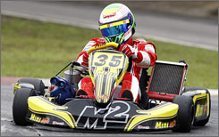 Felipe Massa puts a kart through its paces during a practice session in Sao Paulo.