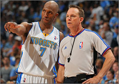 Nuggets guard Chauncey Billups and referee Bill Spooner talk things over during last season's Western Conference finals.
