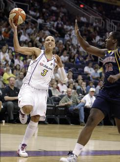 Phoenix Mercury guard Diana Taurasi (No. 3) drives past Indiana Fever forward Ebony Hoffman (No. 32) for a basket in Game 1 of the WNBA finals Tuesday in Phoenix. The Mercury won 120-116 in overtime.