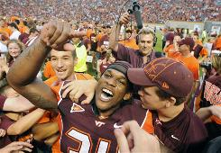 Virginia Tech running back Ryan Williams, swarmed by fans after beating Nebraska, has played well in relief of injured Darren Evans.