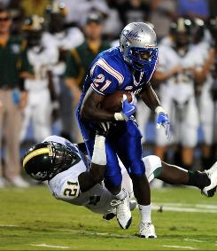 Byrnes Marcus Lattimore gets tackled by Myrtle Beach's Josh Roberts during a Sept. 4 game. Lattimore, one of the highest rated running backs in the country, hopes to lead Byrnes to victory against No.1 St. Thomas Aquinas Friday.