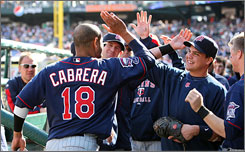 Orlando Cabrera (No. 18) hits a bases-clearing double in the eighth inning to put the Twins up 7-1.