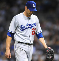 Dodgers starting pitcher Jon Garland walks off the mound after he got roughed up for four runs in 3.1 innings.