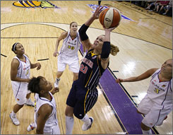 Indiana's Katie Douglas shoots against the Mercury defense in Game 2 of the WNBA Finals.