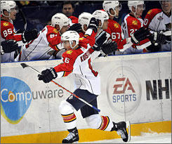 Florida's Ville Koistenen celebrates his winning penalty shot in the Panthers' 4-3 opening day win over the Chicago Blackhawks in Finland on Friday.