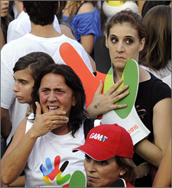 Supporters of the Madrid 2016 Olympic bid react after hearing that Rio had been awarded the Games.