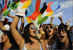 Fans gathered in Madrid celebrate the announcement that their city was voted a finalist for the 2016 Olympic Games.
