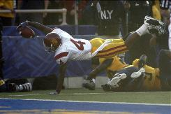 Southern California's Joe McKnight scores a touchdown early in the first quarter against California. McKnight ran for 119 yards Saturday.