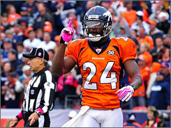 Broncos cornerback Champ Bailey celebrates after breaking up a pass in the end zone during the Cowboys' last-ditch effort to score in the game's closing seconds. Bailey broke up successive passes in Dallas' final two attempts to score, sealing the victory for the Broncos.
