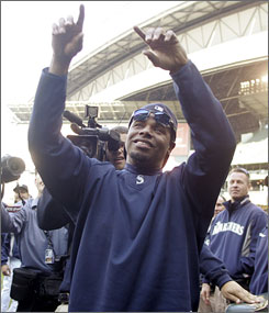 Ken Griffey Jr. points to the crowd following the Mariners 4-3 victory over the Rangers. Griffey, 39, said he would like to return  next year.