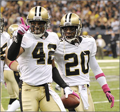 Saints safety Darren Sharper celebrates his second interception on Sunday during New Orleans' victory over the New York Jets. Sharper returned his first interception 99 yards for a touchdown.