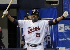 Minnesota Twins' left fielder Delmon Young reacts to a Michael Cuddyer home run on Oct. 3. Young and the twins hope to win their tiebreaker Tuesday against the Detroit Tigers and face the New York Yankees.