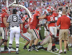 Georgia wideout A.J. Green (8) was flagged for unsportsmanlike conduct for his celebration after catching a touchdown late in the Bulldogs' game against LSU on Saturday.