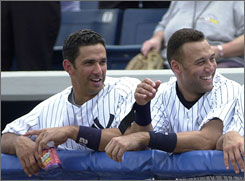 Jorge Posada (left), Derek Jeter (right), Mariano Rivera and Andy Pettitte are the lone holdovers from the Yankees' last championship era, teams that won four World Series titles in five years (1996, 1998-00).