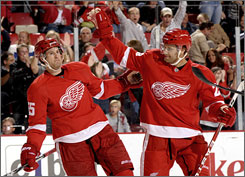 Niklas Kronwall, left, Brad Stuart and the Detroit Red Wings are killing penalties at a 55.6% rate this season, but the team isn't panicking yet.