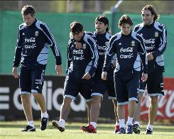 Argentina's players, from left, Martin Palermo, Ezequiel Lavezzi, Sergio Aguero, Lionel Messi and Rolando Schiavi walk during a training session, Tuesday. Argentina will face Peru in a World Cup qualifying match on Oct. 10, amidst conjecture that coach Diego Maradona will soon resign.