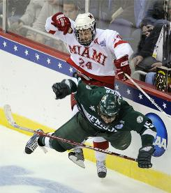Miami's Kevin Roeder (24) checks a Bemidji State player during last season's Frozen Four. Miami (Ohio) hopes to avoid its title game collapse this year and bring the school its first NCAA title in any sport.