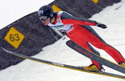 Lindsey Van soars to a world title Feb. 20 in Liberec, Czech Republic.