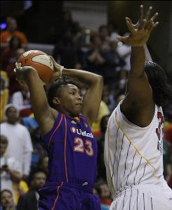Phoenix Mercury guard Cappie Pondexter, left, looks to make a pass while the Indiana Fever's Ebony Hoffman defends. Pondexter scored 22 points in the Mercury's win that evened the WNBA Finals at 2-2. Game 5 is Friday.
