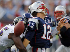 Terrell Suggs, left, was flagged for a roughing-the-passer penalty against Patriots QB Tom Brady on Sunday.