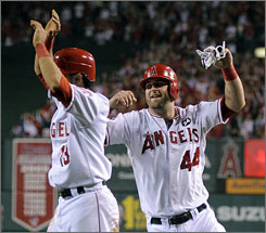 Maicer Izturis (44), celebrating with Angels teammate Mike Napoli, drove in the tiebreaking run that gave Los Angeles the lead for good in Game 2 of the ALDS.