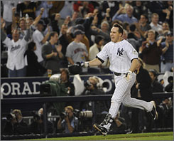 Mark Teixeira celebrates as he approaches home plate after hitting his game-winning home run in the 11th inning to give the Yankees a 2-0 lead over the Twins in their ALDS.