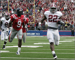 Alabama's Mark Ingram races to the end zone for a 36-yard touchdown as Mississippi's Allen Walker gives chase during the second quarter.