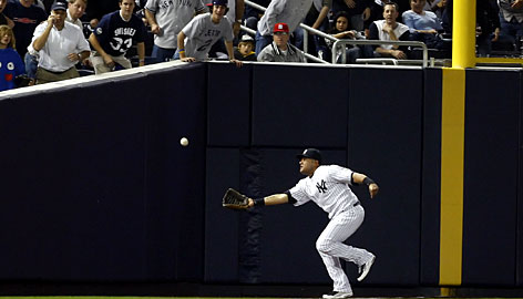 Replays showed this ball hit by Minnesota's Joe Mauer landed fair late in the Twins' loss to the Yankees on Friday night.