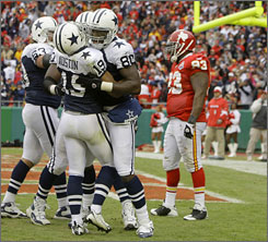 Cowboys receiver Miles Austin and teammates celebrate the first of his two touchdowns on Sunday.