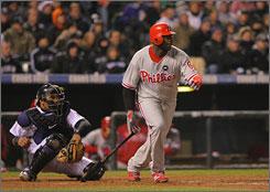 Phillies slugger Ryan Howard hits an RBI single against the Rockies.