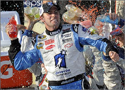 Jimmie Johnson celebrates with a sports-drink shower after securing his fourth win at Auto Club Speedway.