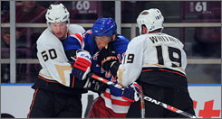 New York's Marian Gaborik is sandwiched by Anaheim defensemen Brendan Mikkelson and Ryan Whitney in the first period. Gaborik later drew an assist on the winning goal.