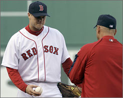 Red Sox manager Terry Francona removes Jonathan Papelbon, left, in the ninth after the closer allowed three runs. Papelbon's blown save eliminated the Red Sox from the postseason. 