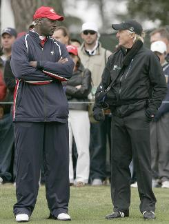 Michael Jordan, chosen as an assistant by U.S. captain Fred Couples, talks with International team captain Greg Norman during the final day of the Presidents Cup on Sunday at Harding Park in San Francisco.