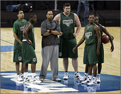 """Binghamton coach Kevin Broadus, center, is under fire after Emanuel """"Tiki"""" Mayben, left, was arrested for selling and possessing cocaine. Broadus also admitted to breaking NCAA rules by making improper contact with a pair of prospects."""