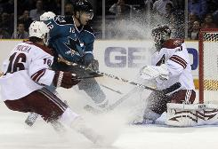 Phoenix Coyotes goaltender Ilya Bryzgalov blocks a shot from San Jose Sharks center Patrick Marleau in the second period of their game in San Jose. At left is Coyotes right wing Petr Prucha. Phoenix shut out San Jose 1-0.
