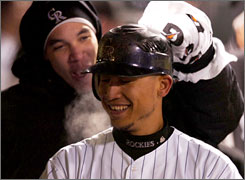 Ubaldo Jimenez, back, has fun Sunday with Carlos Gonzalez, the Rockies' top hitter in the NLDS.
