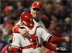 Closer Brad Lidge (rear) and catcher Carlos Ruiz celebrate after the Phillies defeated the Rockies in the NLDS.