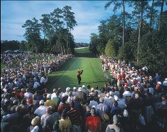 "Sports Illustrated photographer Fred Vuich was surprised this image of Tiger Woods teeing off at Augusta National No. 18 during the 2001 Masters made the cover of the magazine. ""I was shocked to see the photo on the cover of the magazine. That it got the kind of shelf life that it has."" The image is reprinted in Sports Illustrated: The Golf Book."