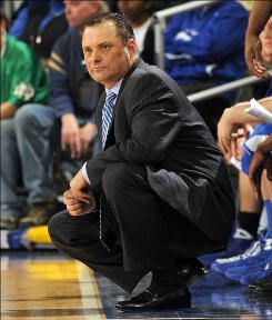 Former Kentucky coach Billy Gillispie and the university settled their dispute Monday, stemming from his firing earlier in the year.
