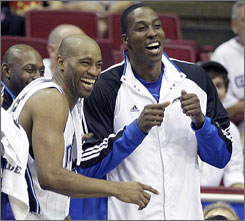 Magic teammates Vince Carter, left, and Dwight Howard enjoy the final stages of an exhibition victory over the Rockets on Oct. 9.