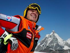 Austrian ski star Hermann Maier smiles in front of the Matterhorn in 2002.