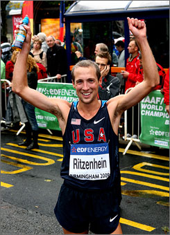 Dathan Ritzenhein celebrates his third-place finish at the world half-marathon championship on Sunday.