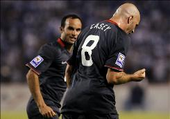 The USA's Conor Casey, front, celebrates with teammate Landon Donovan after scoring during a 2010 World Cup qualifying match at Honduras. The USA won 3-2 and qualified for the 2010 World Cup.