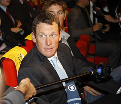 Lance Armstrong talks to reporters after the unveiling of the 2010 Tour de France route.