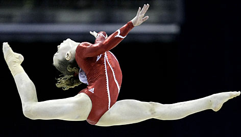 American Rebecca Bross competes in the floor routine Wednesday at the world gymnastics championships in London. She placed first overall in the preliminary competiton.