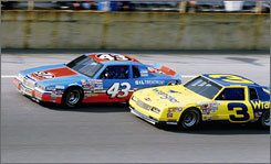Richard Petty (43) and Dale Earnhardt race side-by-side at Daytona in 1985. The only two seven-time NASCAR champions were voted into the Hall of Fame's inaugural class.