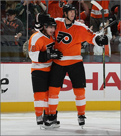 Philadelphia hopes veteran defenseman Chris Pronger, right, celebrating with Flyers teammate Mike Richards on Oct. 6, is the piece that has been missing in its quest for a Stanley Cup title.