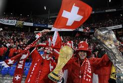 Switzerland's supporters jubilate after their team won to be qualified for the World Cup.