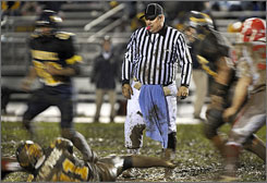 Football referee Phil Divito keeps a steady eye on the action during a game between Plainfield and Mooresville in Indiana.